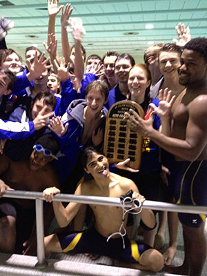 The Varsity Boys Swim Team pose for a picture after reclaiming the city kick board trophy.