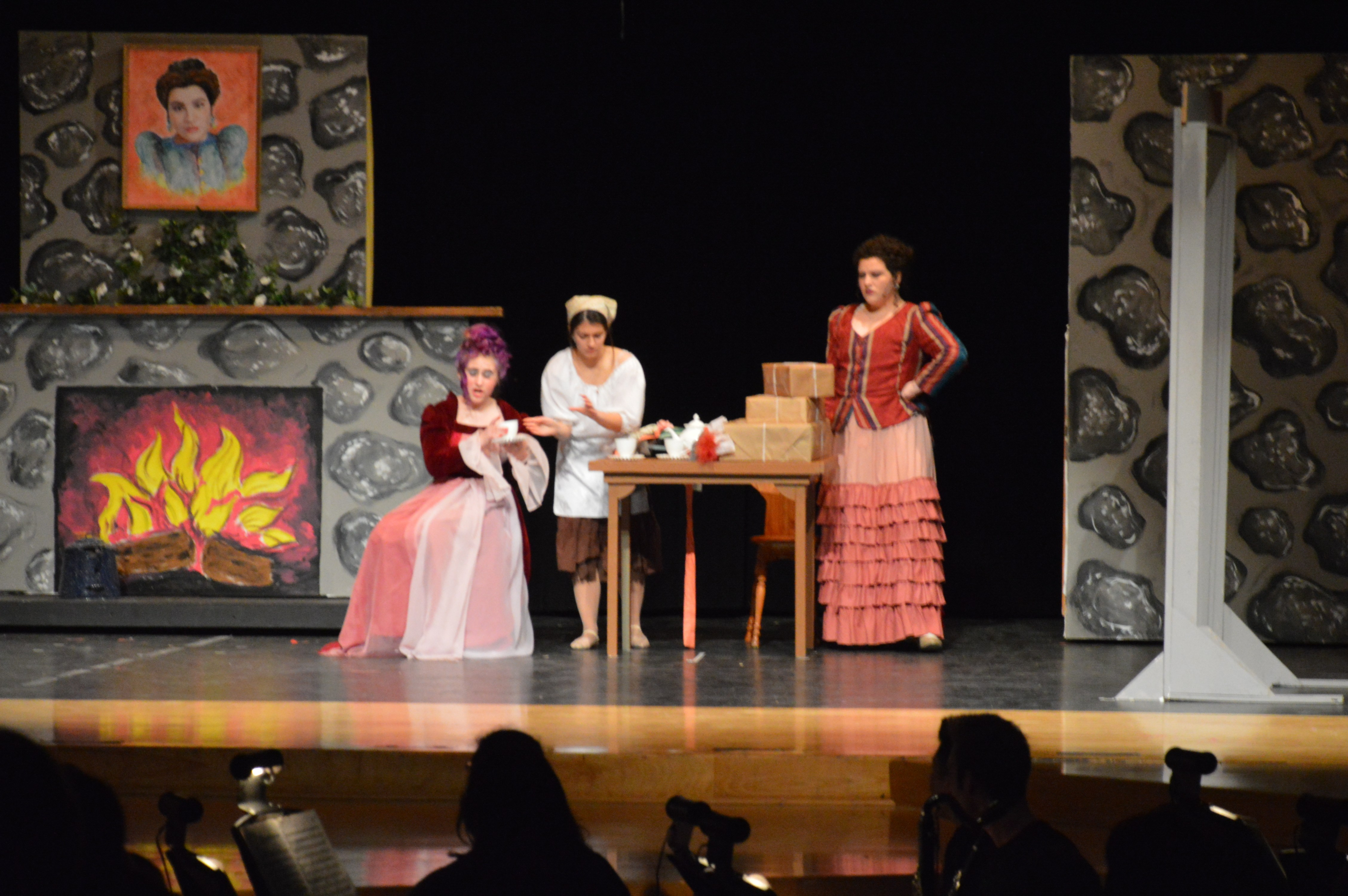 Cinderella (Emily Ferrera '15) serves tea to her stepmother and stepsisters (Mia Hernandez, Caitlyn Skiba '15 and Shyann Colton '16.)