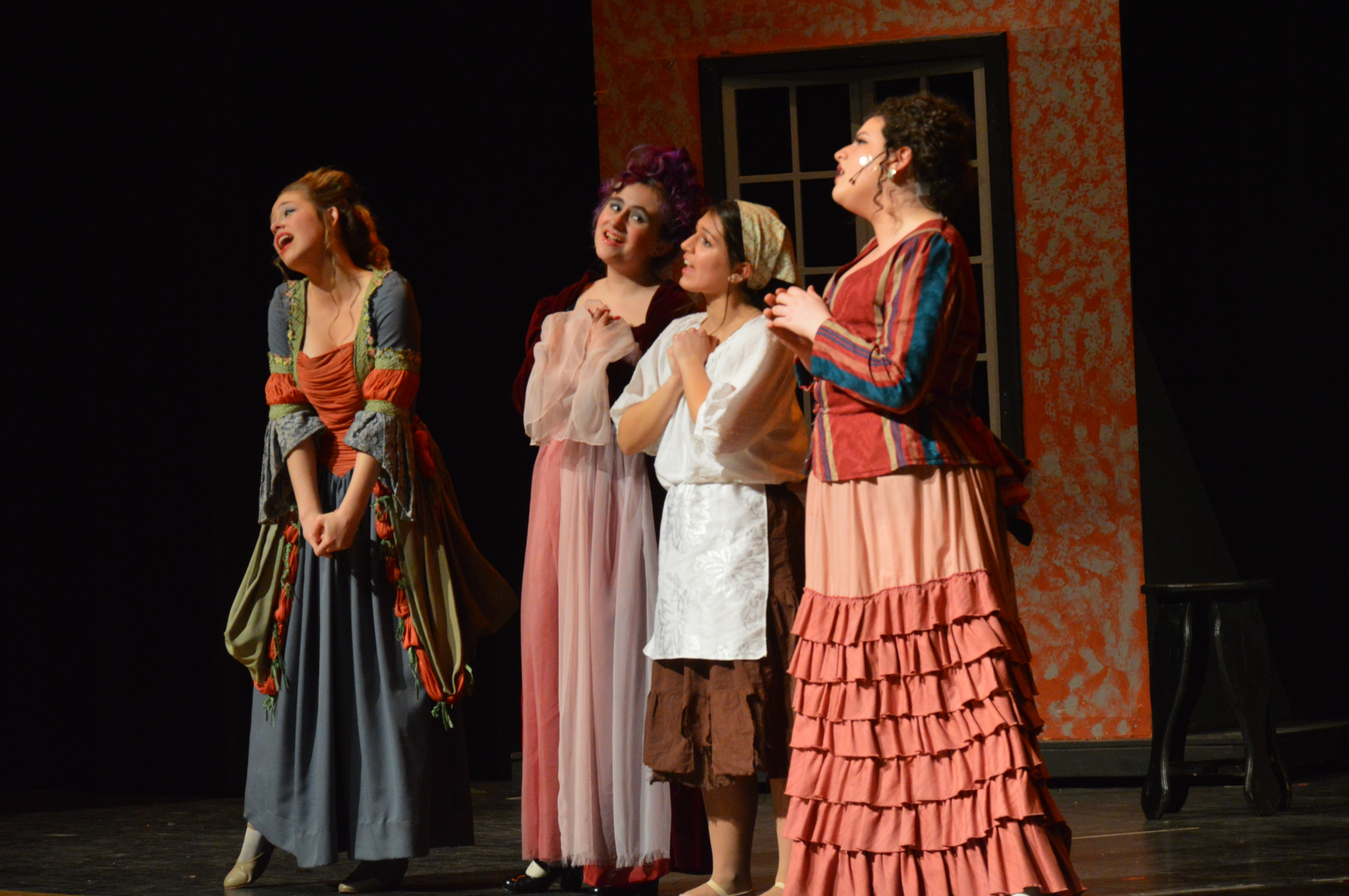 Cinderella, her stepmother and stepsisters sing about their wishes to marry the Prince and move into the Castle.