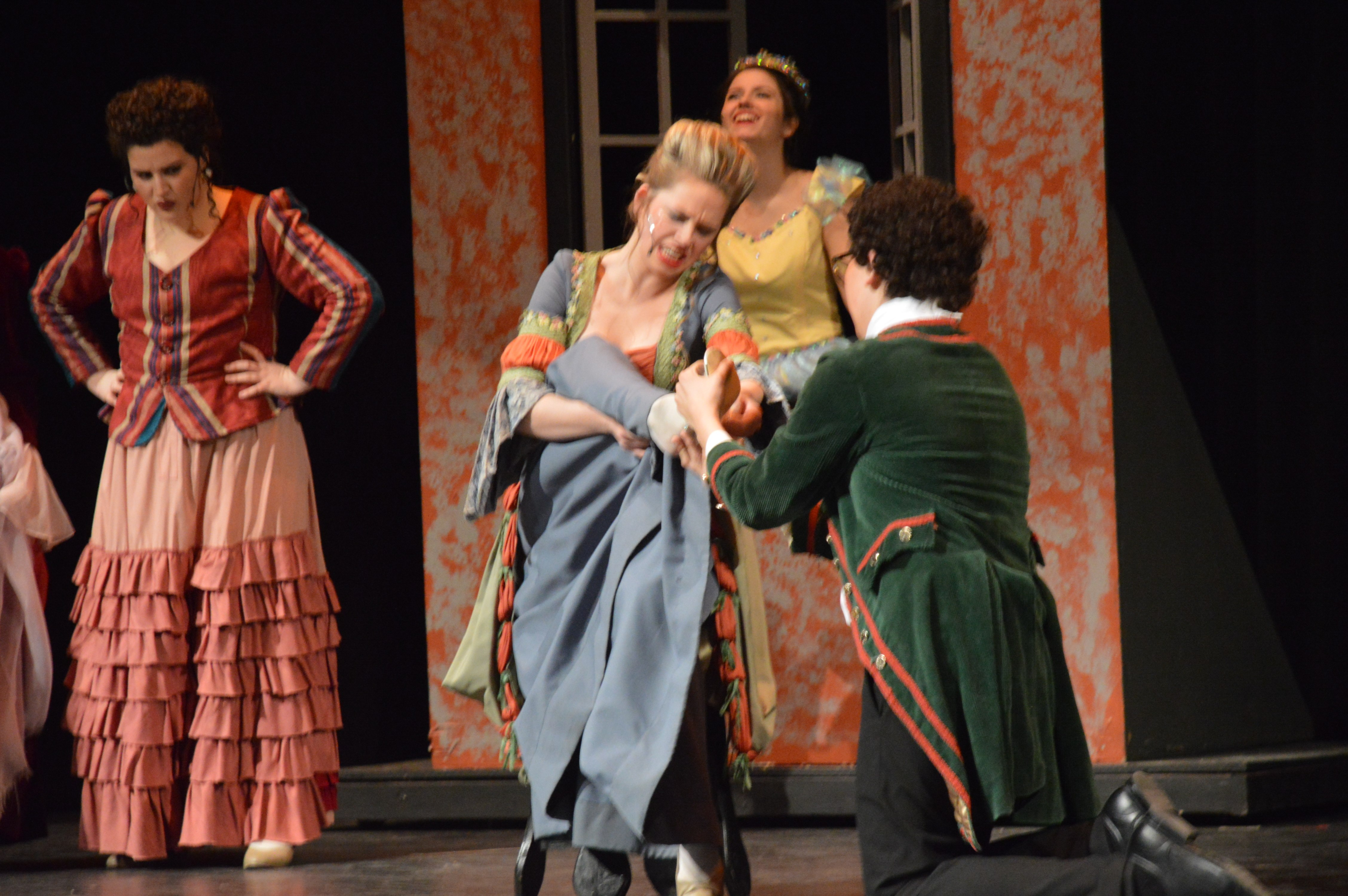 Stepsister, Caitlyn Skiba, tries to force her foot into the shoe so that she may marry the Prince.