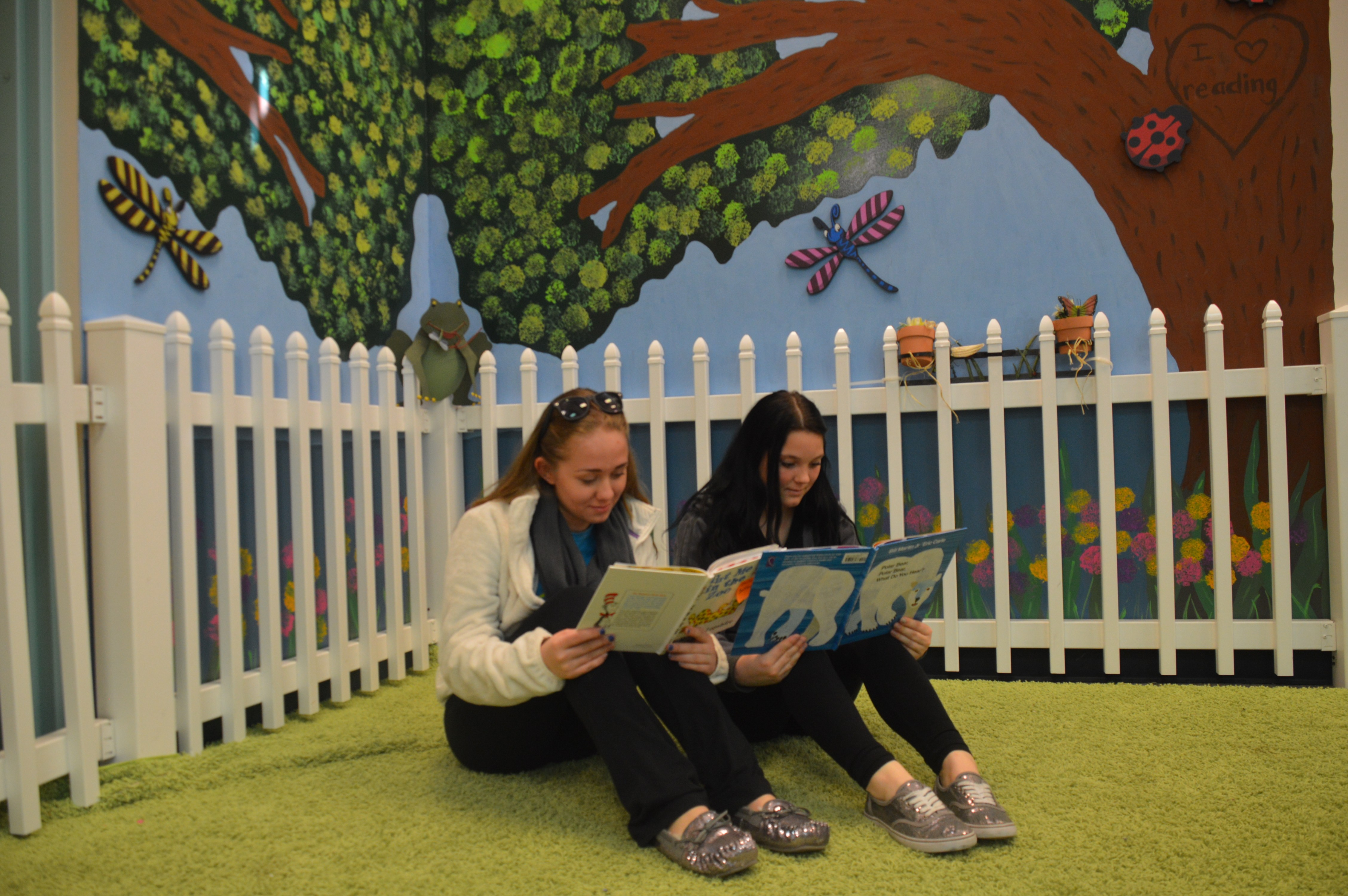 Brianna Sullivan '16 and Kym Shaffer '15 select their books that they will read to elementary students.