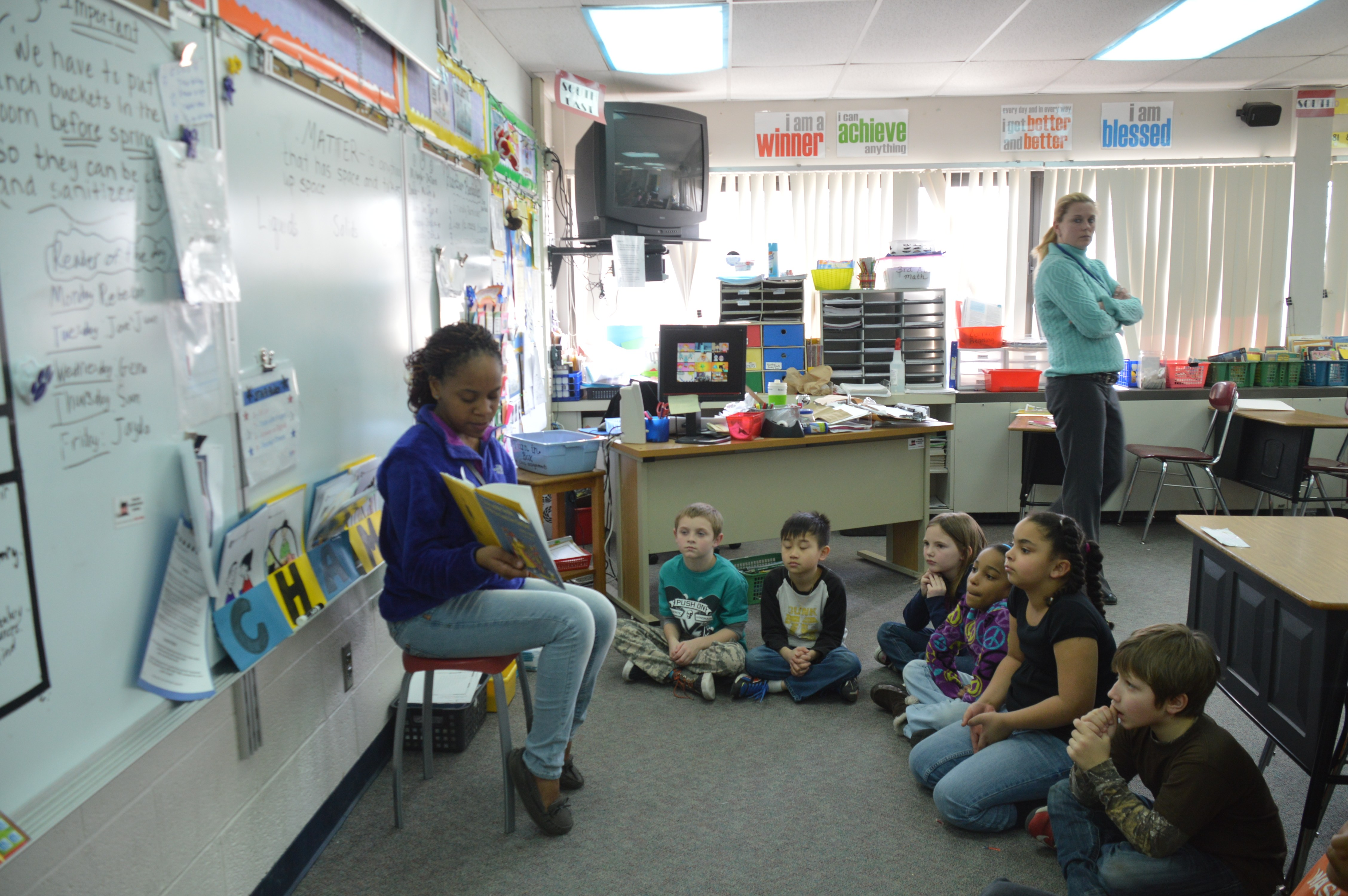 Children pay close attention to Jasmine Walker '16 as she captivates their imaginations during story time.