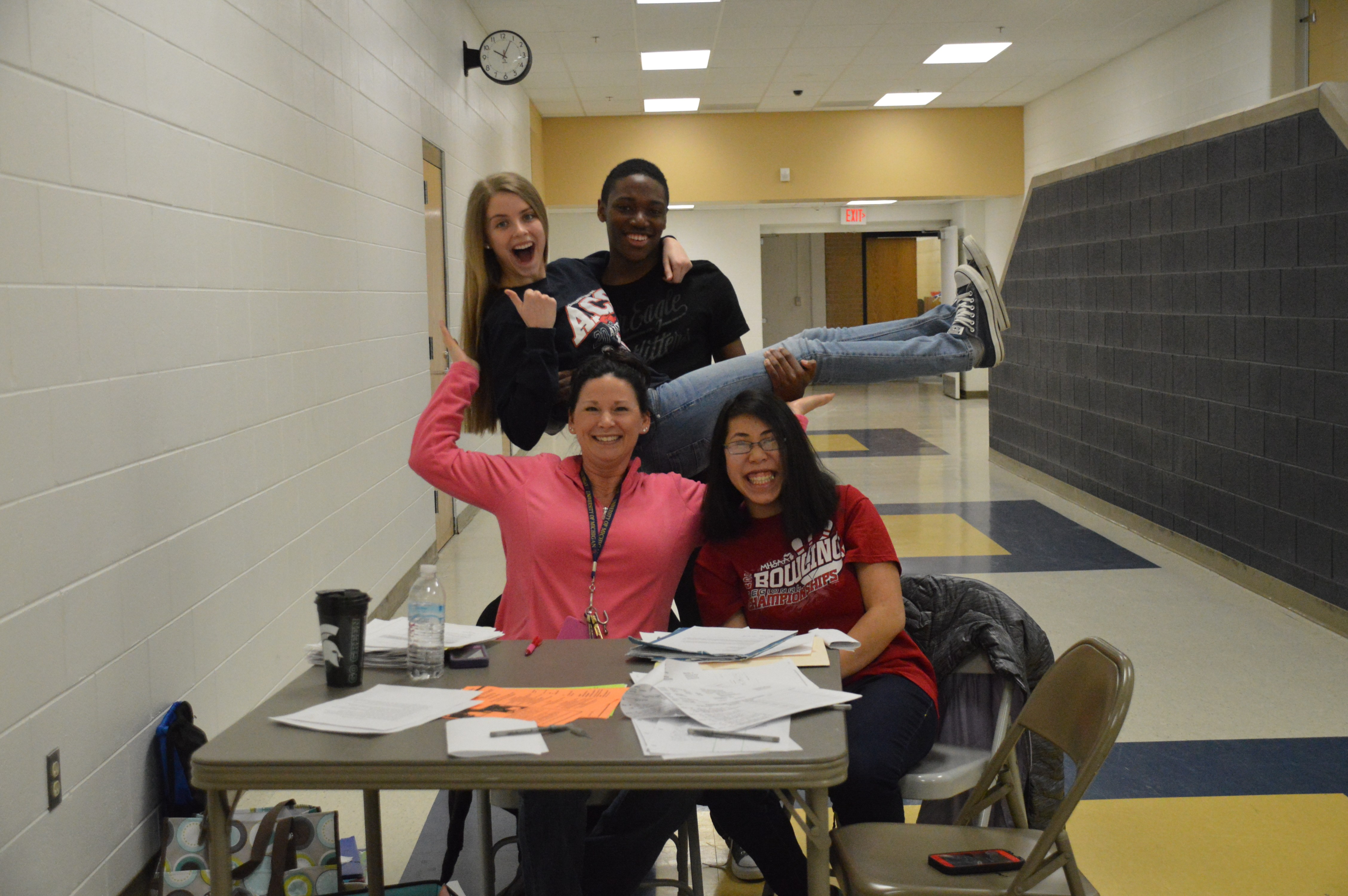 NHS Advisor Julie Bukowski, poses with her students while running the blood drive.