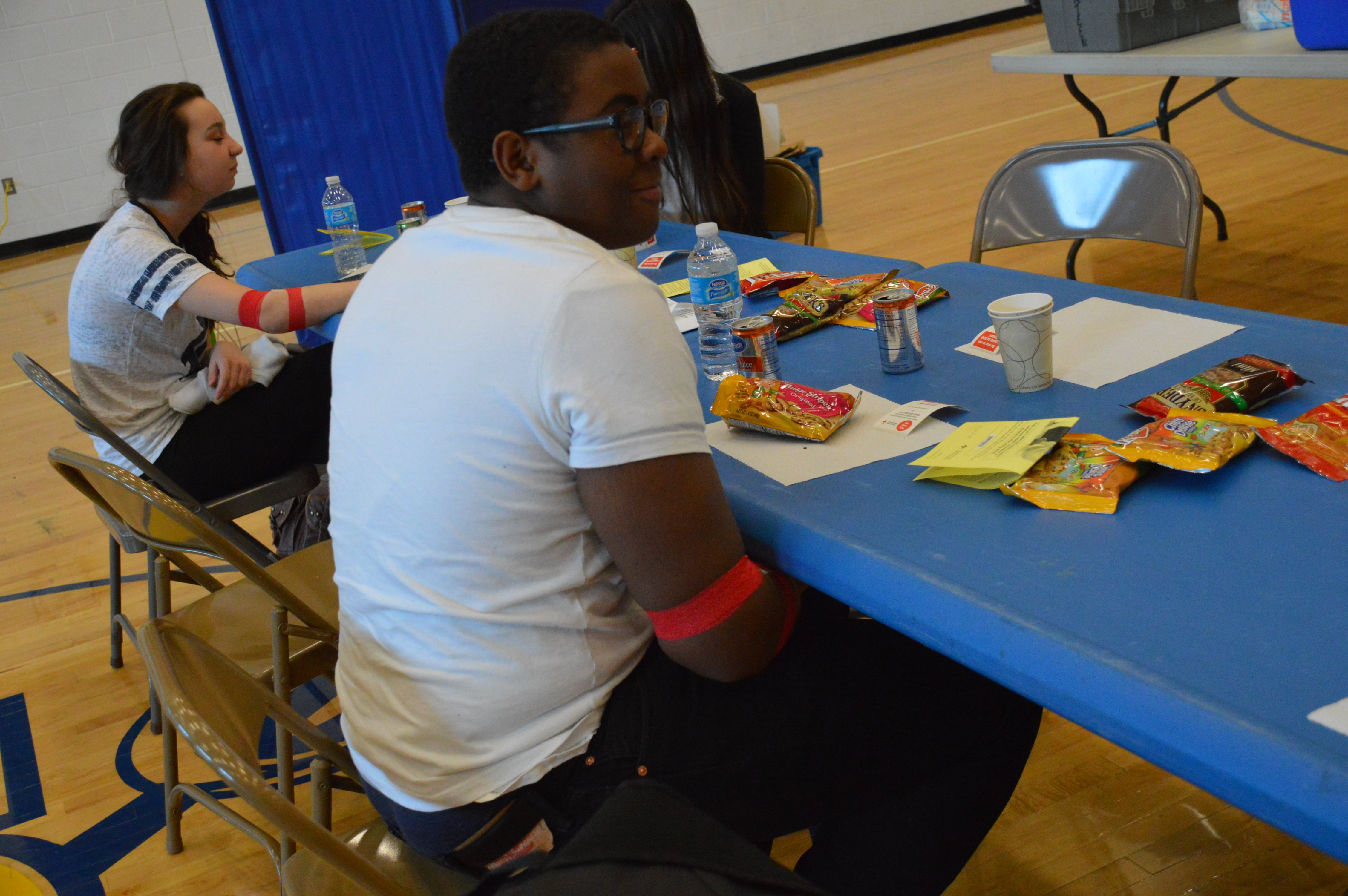 After giving blood, students are required to sit and eat some snacks provided by the NHS Members.
