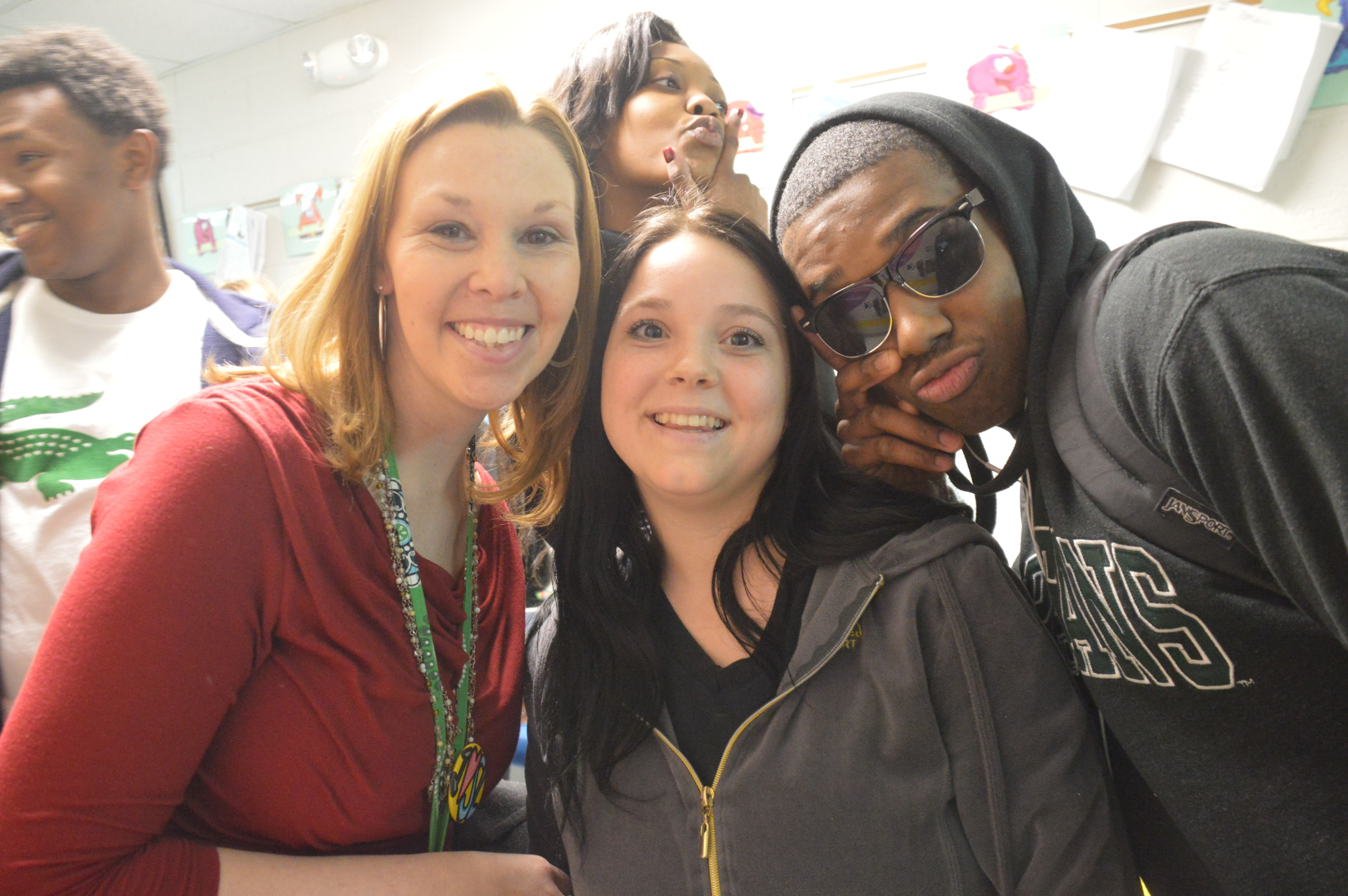 Mrs. Geiger, Kym Shaffer '15 and Michael Branch '16 pose for a photo at the elementary schools.