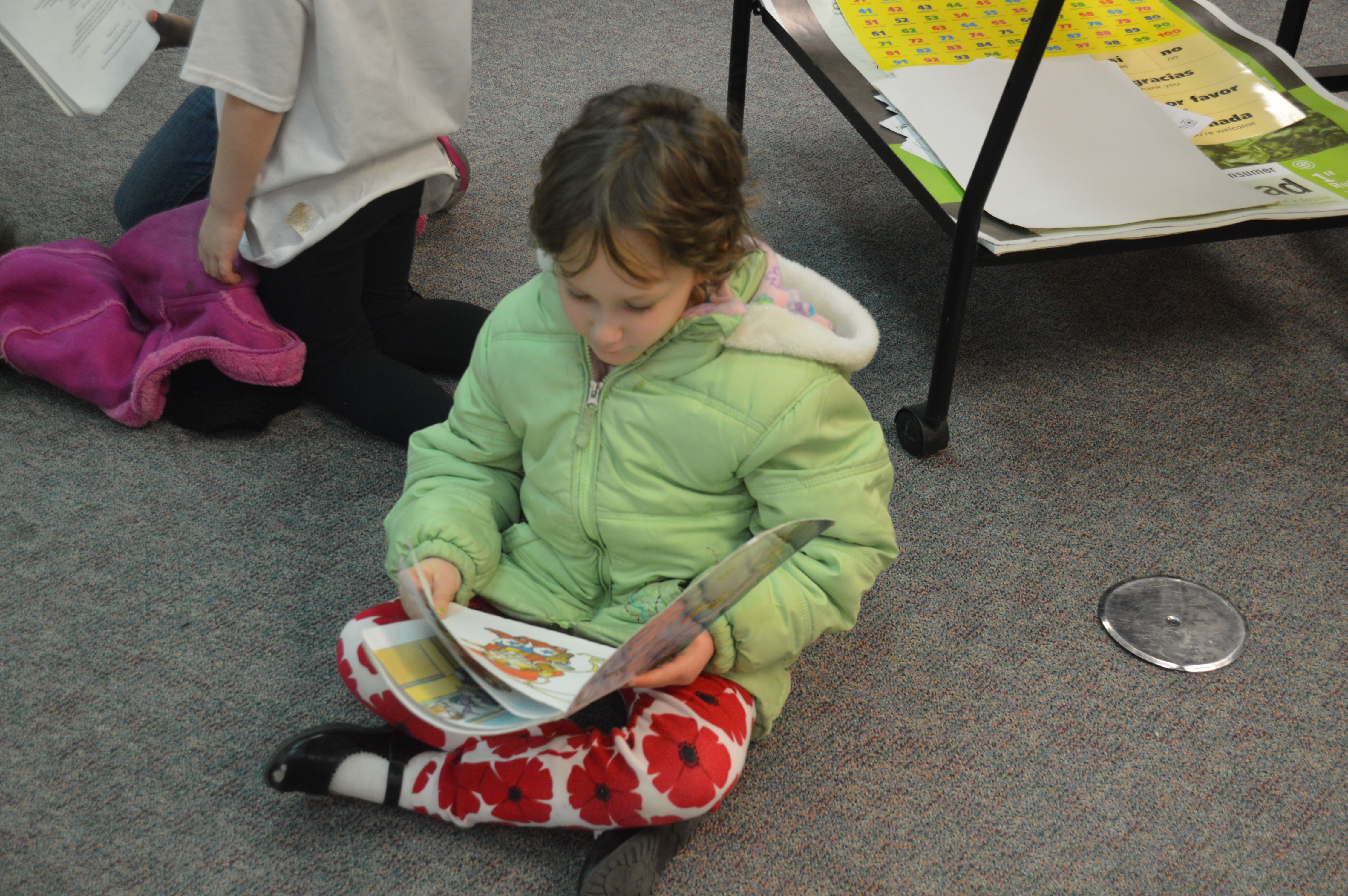 Students were able to check out a copy of the book being read and follow along with the reader.