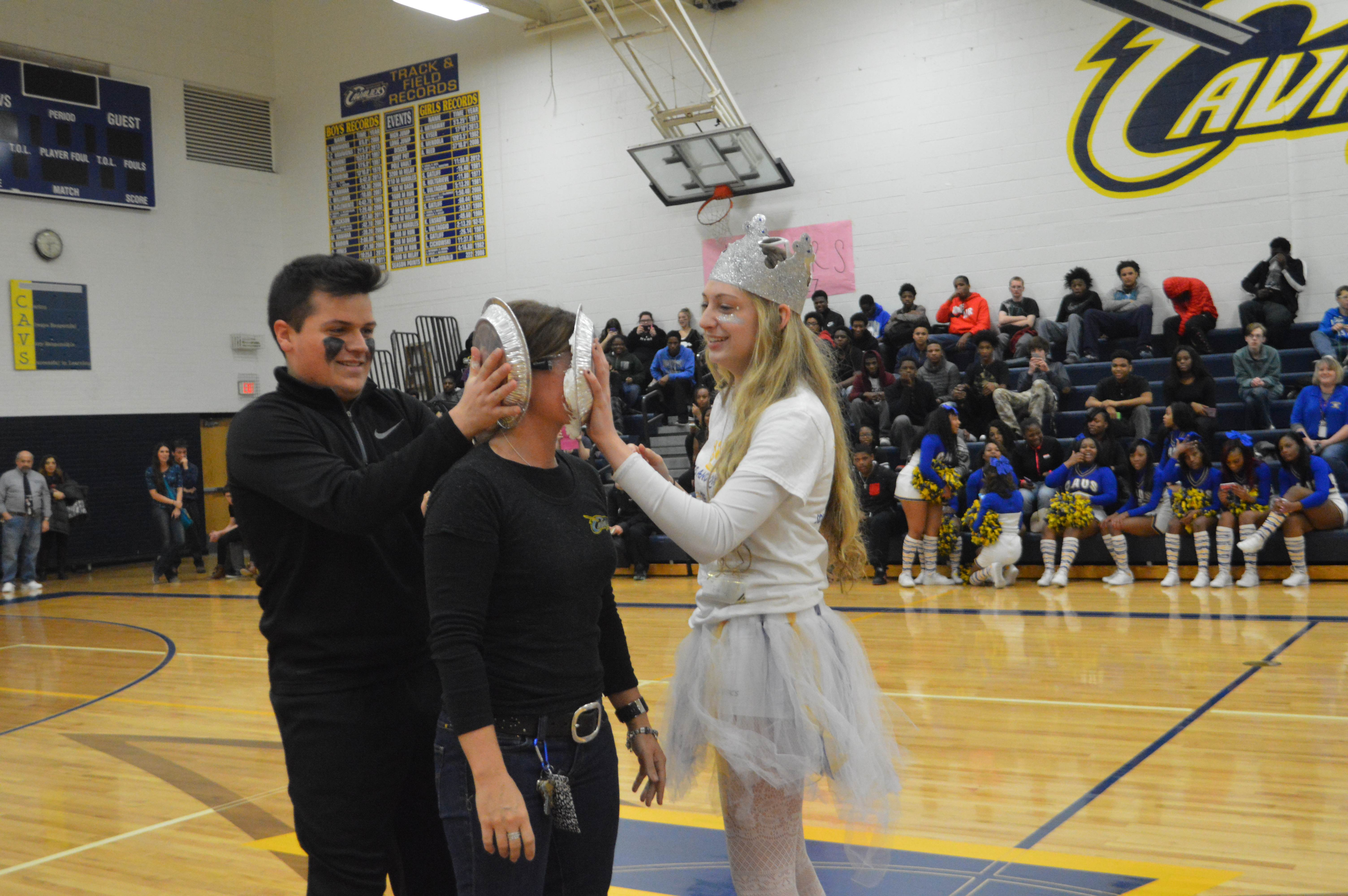 With goggles on, English Teacher Jennifer Boggio takes two pies to the face from Theo Pozios '17 and Emily Estrada '16.