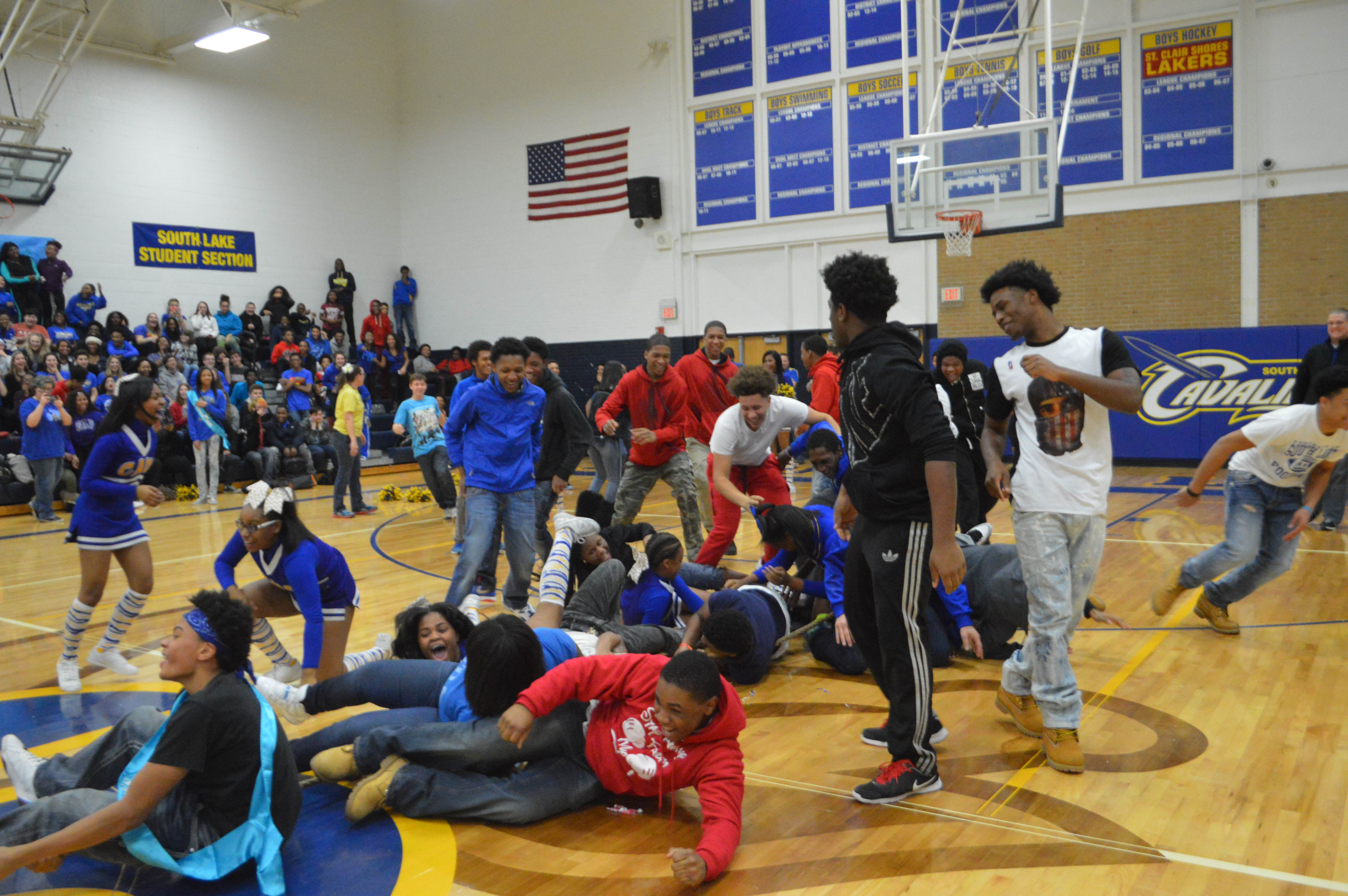 As the freshman team begins to lose tug of war, a swarm of freshman come down to help out their classmates.