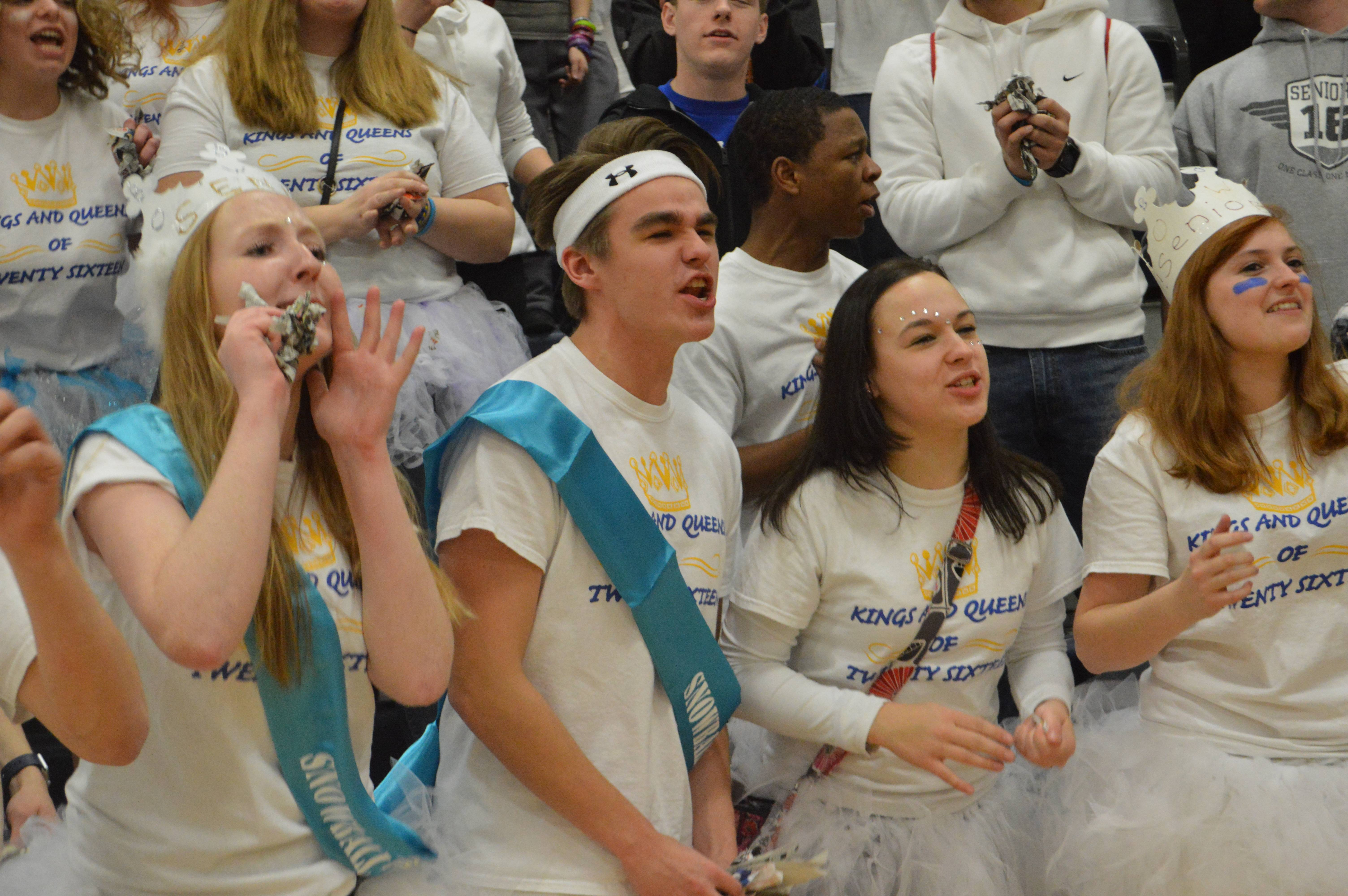 Dressed in white, Emily Raleigh, Matt Millstein and Sara Brown '16 chant their battle cry at the end of the pep rally.
