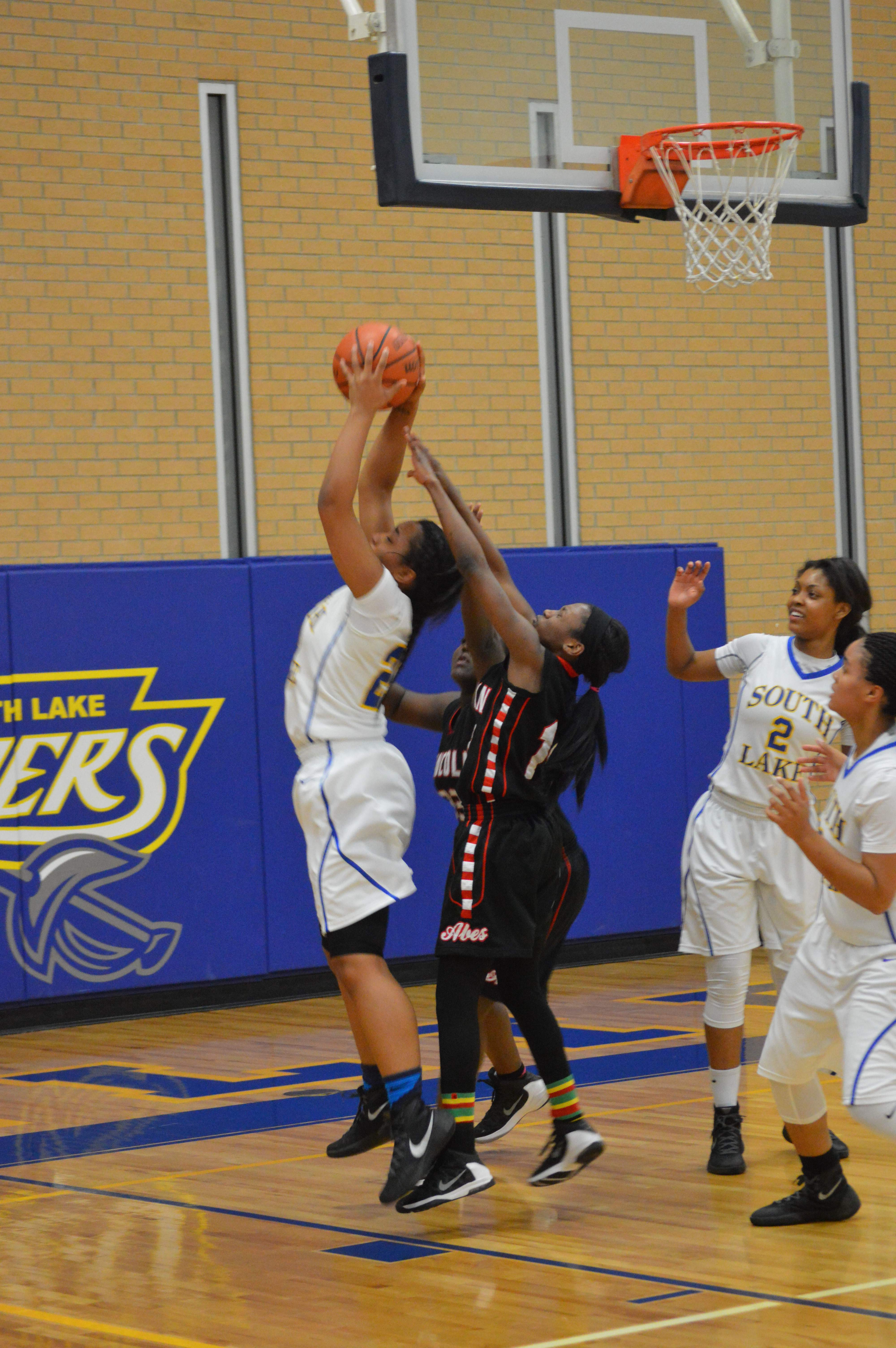 Determined to block Lincoln, Chantonia Lowry '16 grabs the ball in midair.