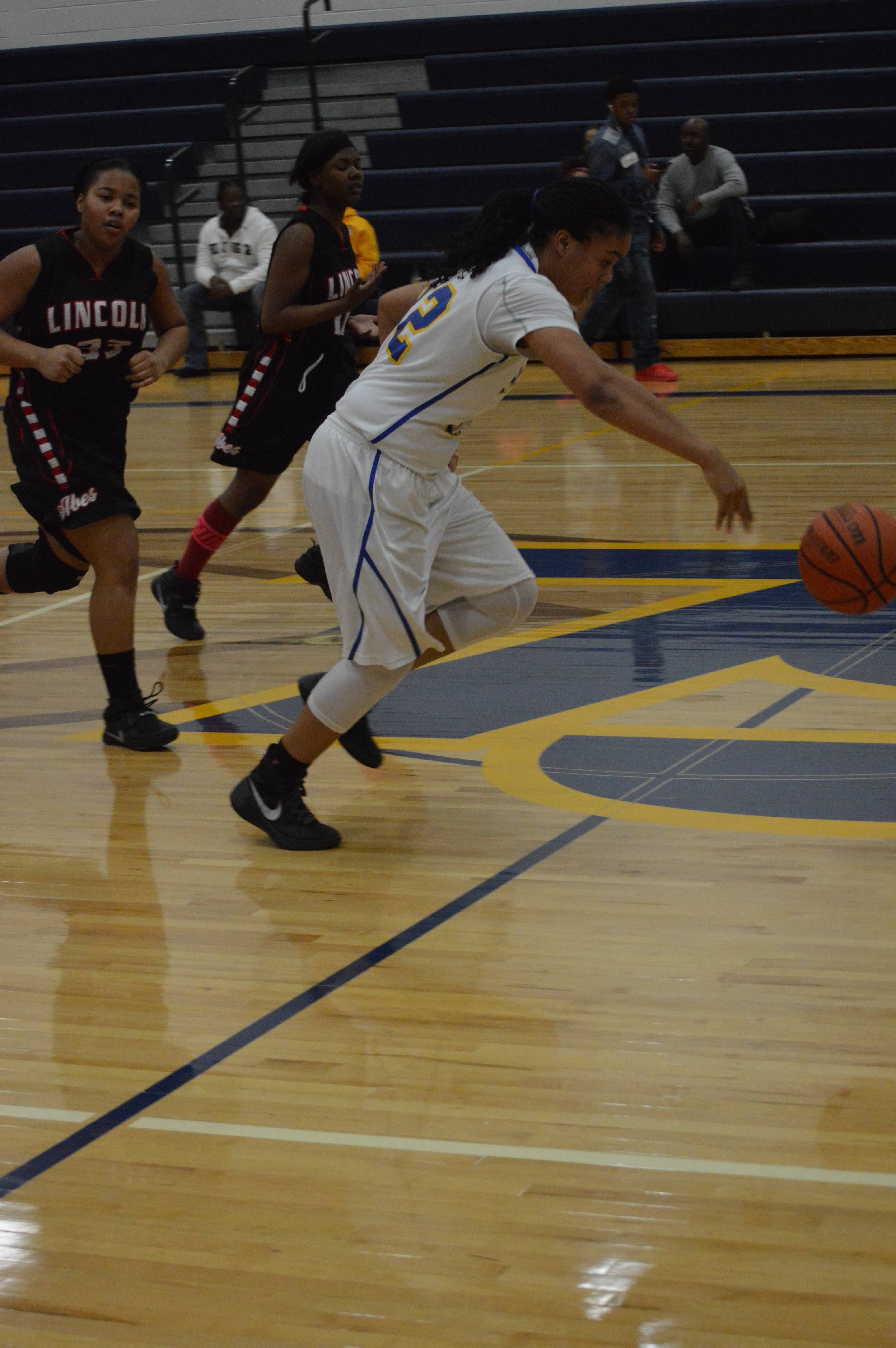 With defenders on her heels, Williams hustles down the court.